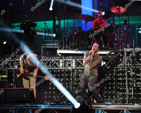 JUNE 30: Michael Madden,Adam Levine and Matt Flynn of Maroon 5 perform at the IHeartRadio concert at Fontainebleau Miami Beach on in Miami Beach, Florida