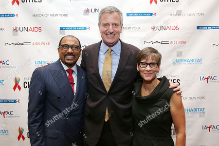 Michel Sidibe, Executive Director of UNAIDS, New York City Mayor Bill de Blasio and Nancy Mahon, Global Global Executive Director, M·A·C AIDS Fund seen at a Global Meeting of Mayors on ending AIDS in cities at the New York Public Library on in New York