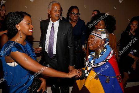 From left), Stedman Graham, Oprah Winfrey, Jacquie Lee and South African artist and (Belvedere) RED collaborator Esther Mahlangu seen greeting student from The Oprah Winfrey Leadership Academy for Girls - South Africa as Major Contributor Moet Hennessy Celebrates the Unveiling of the National Museum of African American History & Culture (NMAAHC) on backstage at The Kennedy Center in Washington D.C