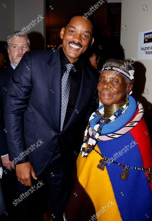 Will Smith and South African artist and (Belvedere) RED collaborator Esther Mahlangu seen as Major Contributor Moet Hennessy Celebrates the Unveiling of the National Museum of African American History & Culture (NMAAHC) on backstage at The Kennedy Center in Washington D.C
