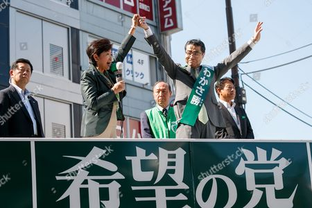 (L to R) Yuriko Koike, Tokyo Governor and leader of the new national party, Kibo no To (Party of Hope) and candidate Masaru Wakasa, hold hands during a campaign event outside Ikebukuro Station, Tokyo, Japan. Koike offered her support to candidate Masaru Wakasa. Koike herself will not run in the election and has vowed to stay on as Tokyo Governor until the Tokyo 2020 Olympic Games. She has however set up a new national party to challenge the ruling Liberal Democratic Party. Election campaigning officially stated today on October 10 and the election will be held on October 22.