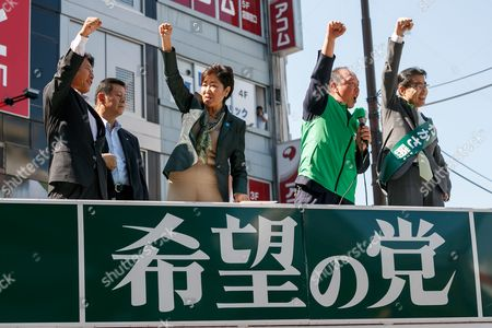 (C-L) Yuriko Koike, Tokyo Governor and leader of the new national party, Kibo no To (Party of Hope) and candidate Masaru Wakasa (R), rise hands during a campaign event outside Ikebukuro Station, Tokyo, Japan. Koike offered her support to candidate Masaru Wakasa. Koike herself will not run in the election and has vowed to stay on as Tokyo Governor until the Tokyo 2020 Olympic Games. She has however set up a new national party to challenge the ruling Liberal Democratic Party. Election campaigning officially stated today on October 10 and the election will be held on October 22.