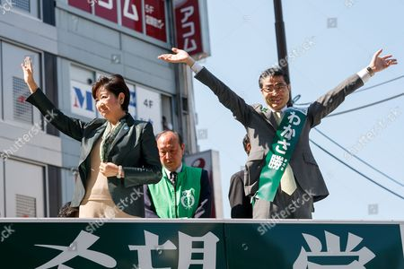 (L to R) Yuriko Koike, Tokyo Governor and leader of the new national party, Kibo no To (Party of Hope) and candidate Masaru Wakasa, wave hands during a campaign event outside Ikebukuro Station, Tokyo, Japan. Koike offered her support to candidate Masaru Wakasa. Koike herself will not run in the election and has vowed to stay on as Tokyo Governor until the Tokyo 2020 Olympic Games. She has however set up a new national party to challenge the ruling Liberal Democratic Party. Election campaigning officially stated today on October 10 and the election will be held on October 22.