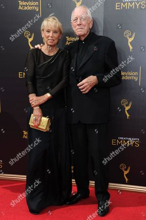 Catherine Brelet, left, and Max von Sydow arrive at night one of the Creative Arts Emmy Awards at the Microsoft Theater, in Los Angeles