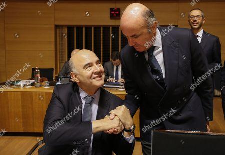 Pierre Moscovici and Luis De Guindos Jurado
