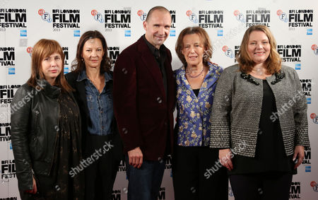 British Screenwriter and playwright Abi Morgan, left poses alongside Producer Gabrielle Tana, 2nd left, British actor and Director for the film, Ralph Fiennes, centre, author Claire Tomalin, 2nd right, and British actress Joanna Scanlan, during a photo call for the film, The Invisible Woman, as part of the 57th BFI London Film Festival, in a central London hotel