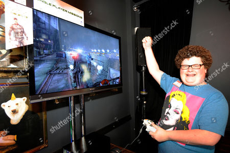 IMAGE DISTRIBUTED FOR UBISOFT - Actor Jesse Heiman reacts to playing Tom Clancy's Splinter Cell Blacklist in the Players' Lounge hosted by Aisha Tyler and Ubisoft's Watch Dogs during the 2013 Comic-Con International Convention, in San Diego, Calif