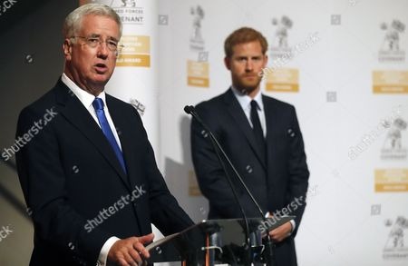 Secretary of State for Defense Michael Fallon and Prince Harry