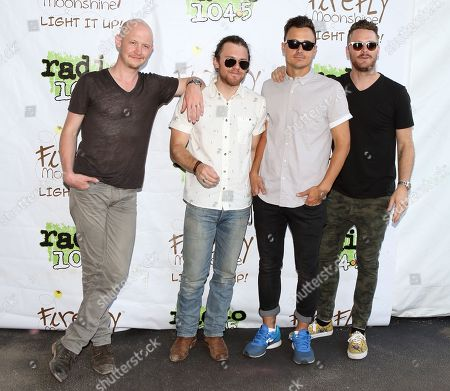 Stock Image of Isaac Slade, from left, Dave Welsh, Joe King and Ben Wysocki of the band The Fray pose for photographers backstage at Festival Pier, in Philadelphia