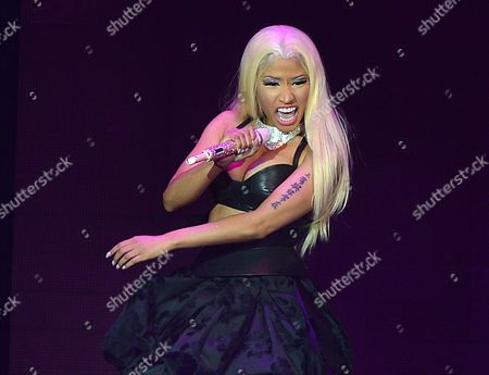 Nicki Minaj performing at the O2 in London. Minaj and her mentor, Lil Wayne, will join forces for a performance at the Billboard Music Awards, to be presented in Las Vegas on May 19. Billboard announced additional performers Thursday. They include Chris Brown, Jennifer Lopez, Ed Sheeran, David Guetta, Akon, Ne-Yo and Icona Pop