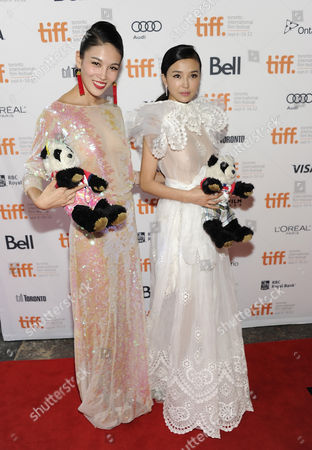 """Chinese actresses Zhang Lanxin, left, and Yao Xingtong arrive at """"In Conversation With Jackie Chan"""" during the Toronto International Film Festival on in Toronto"""