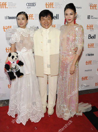 """Chinese actresses Yao Xingtong, left, and Zhang Lanxin pose with actor Jackie Chan arrive at """"In Conversation With Jackie Chan"""" during the Toronto International Film Festival on in Toronto"""