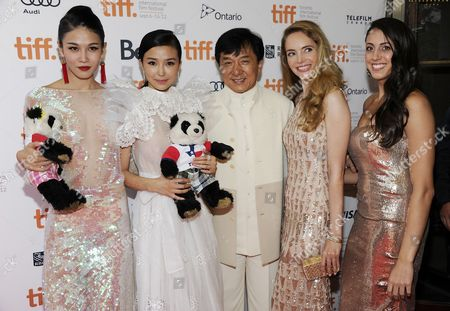 "Actors, from left, Zhang Lanxin, Yao Xingtong, Jackie Chan, Laura Weissbecker and Caitlin Dechelle arrive at ""In Conversation With Jackie Chan"" during the Toronto International Film Festival on in Toronto"