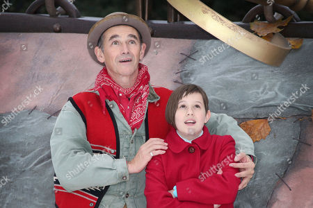 Actors Mark Rylance, left and Ruby Barnhill pose for photographers during a photo call of the film, The BFG, at Potters Field by Tower Bridge in London