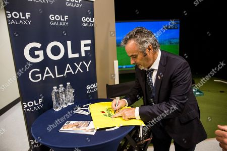 Golf commentator David Feherty signs an autograph at the new Golf Galaxy at the Shoppes at Parkwest in Katy, TX as part of the retailer's grand opening celebration on