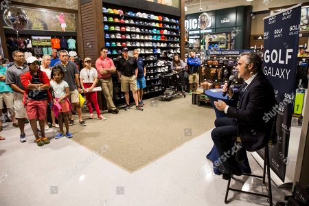 Golf commentator David Feherty addresses the crowd during Q&A at the new Golf Galaxy at the Shoppes at Parkwest in Katy, TX as part of the retailer's grand opening celebration on