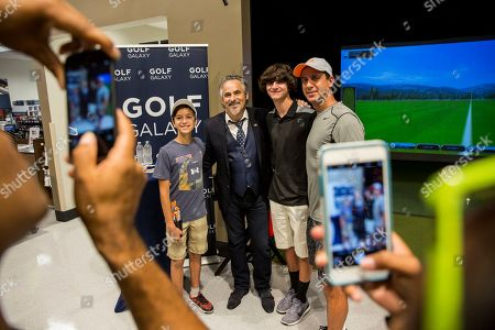 Golf commentator David Feherty poses for a photo with fans at the new Golf Galaxy at the Shoppes at Parkwest in Katy, TX as part of the retailer's grand opening celebration on