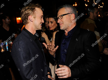 "Tom Felton, left, a cast member in ""In Secret,"" mingles with the film's writer/director Charlie Stratton at the post-premiere party for the film, in Los Angeles"