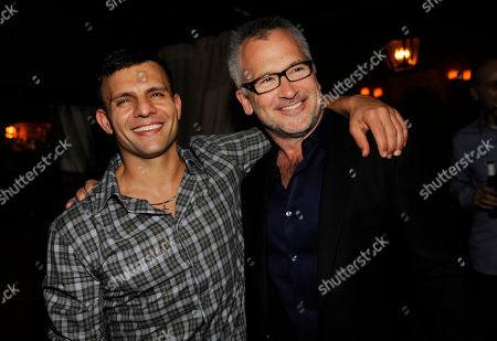 "Charlie Stratton, right, writer/director of ""In Secret,"" poses with producer Pete Shilaimon at the post-premiere party for the film, in Los Angeles"