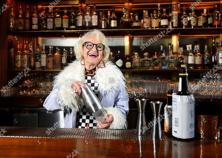 In this image distributed for Hotels.com, Baddie Winkle checked off her New York City #BadAssBucketList activity with Hotels.com® at The Roof at The Viceroy Hotel where she jumped behind the bar to have a one-on-one lesson on how to craft her own cocktails while gazing at the New York City skyline. Baddie Winkle's #BadAssBucketList celebrates Hotels.com® Rewards ? if only everything in life was as rewarding as Hotels.com® Rewards