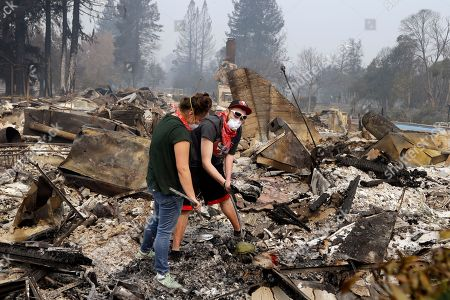 Robyn & Daniel Pellegrini search for belongings in the ashes of their home that was destroyed by fire in the Coffey Park area of Santa Rosa, Calif., on . An onslaught of wildfires across a wide swath of Northern California broke out almost simultaneously then grew exponentially, swallowing up properties from wineries to trailer parks and tearing through both tiny rural towns and urban subdivisions