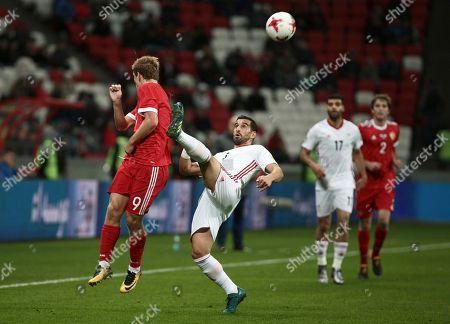 Ehsan Hajsafi, Alexander Kokorin. Iran's Ehsan Hajsafi, center, and Russia's Alexander Kokorin vie for the ball, during the friendly soccer match between Russia and Iran, in Kazan, Russia, on