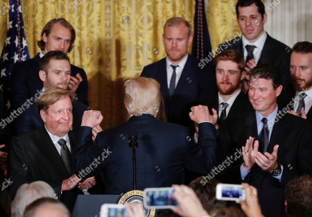 Donald Trump, Ronald Burkle, Mario Lemieux. President Donald Trump turns around and pumps his fist after speaking during a ceremony honoring the 2017 NHL Stanley Cup Champion Pittsburgh Penguins, in the East Room of the White House in Washington. Looking on applauding are Penguins' owners Ronald Burkle, left, and Mario Lemieux, right