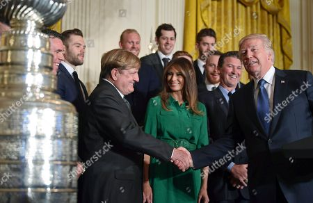 Donald Trump, Melania Trump, Ronald Burkle. President Donald Trump, right, shakes hands with Pittsburgh Penguins owner Ronald Burkle, third from left, as first lady Melania Trump, center in green, watches, with Mario Lemieux during a ceremony to honor the 2017 NHL Stanley Cup Champion Pittsburgh Penguins, in the East Room of the White House in Washington