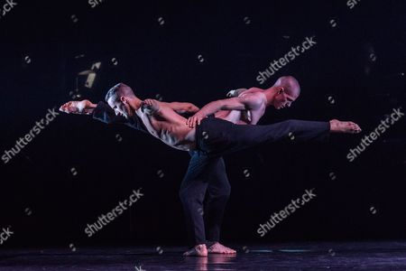 """Stock Picture of Balletboyz return to London's Sadler's Wells for the world premiere of FOURTEEN DAYS, before embarking on a tour across the UK. The new work has been created by four internationally celebrated choreographers, alongside composers, and comprises four short pieces, run alongside FALLEN, by Russell Maliphant. This piece is:  """"Us"""", choreographed by Christopher Wheeldon, with music by Keaton Henson. The dancers in this piece are: Jordan Robson and Bradley Waller."""