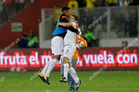 Andy Polo, Aldo Corzo. Peru's Aldo Corzo, right, and Andy Polo celebrate after playing Colombia to a 1-1 draw during a World Cup qualifying soccer match against Colombia in Lima, Peru