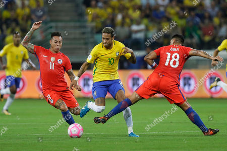 XWCUPSOUTHX. Chile's Eduardo Vargas, left, and Gonzalo Jara fight for the ball with Brazil's Neymar during a World Cup qualifying soccer match in Sao Paulo, Brazil