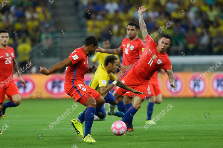 XWCUPSOUTHX. Chile's Eduardo Vargas, right, and Gonzalo Jara fight for the ball with Brazil's Neymar during a World Cup qualifying soccer match in Sao Paulo, Brazil