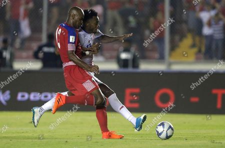 Costa Rica's Rodney Wallace, behind, fights for the ball with Panama's Adolfo Machada during a 2018 Russia World Cup qualifying soccer match in Panama City