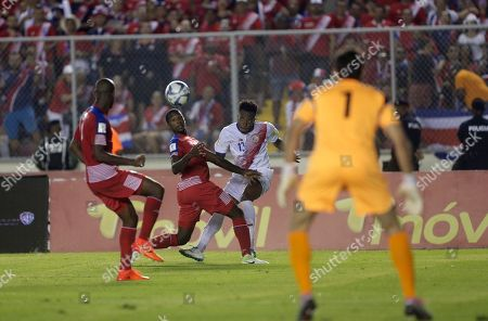 Costa Rica's Rodney Wallace, second from right, fights for the ball during a 2018 Russia World Cup qualifying soccer match with Panama, in Panama City