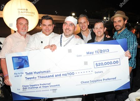 Career Education Scholarship Fund director Terry Frederikson, left, chef Todd English, Le Cordon Bleu student Todd Huelsman, center, Bon Appetit editor-in-chief Adam Rapoport, Chase Sapphire Marketing Director Jeff Bedard and Bon Appetit food & drinks editor Andrew Knowlton, right, pose together for the $20,000 check presentation at the Chase Sapphire Preferred Grill Challenge during Vegas Uncork'd by Bon Appetit, at the Bellagio on in Las Vegas