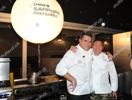 Stock Image of Chef Todd English, left, and chef Akira Back participate in the Chase Sapphire Preferred Grill Challenge during Vegas Uncork'd by Bon Appetit, at the Bellagio on in Las Vegas
