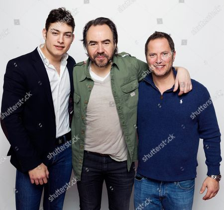 """Stock Photo of Toto Dumitrescu, from left, director Bobby Paunescu and David Lipper pose for a portrait to promote the film, """"Pioneers' Palace"""", at the Eddie Bauer Adventure House during the Sundance Film Festival, in Park City, Utah"""