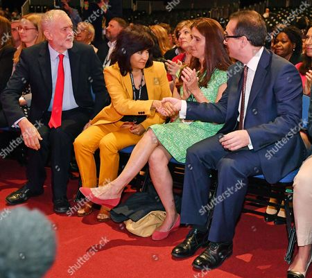 (l To R) Jeremy Corbyn With Wife Laura Alvarez Liz Smith With Husband Owen Smith React As The Announcement Is Made In The Leadership Election- Labour Party Annual Conference At The Liverpool Exhibition Centre Merseyside.-.