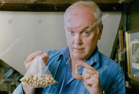 Actor Kenneth Cope With Finger Bone He Found In A Packet Of Nuts. Box 759 1025051768 A.jpg.