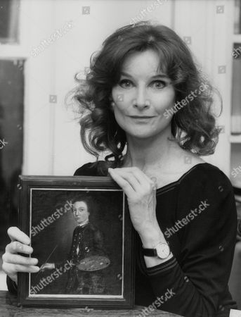 Stock Picture of Actress Adrienne Corri With Portrait Of David Garrick Thought To Be An Early Gainsborough Painting. Box 760 630051748 A.jpg.