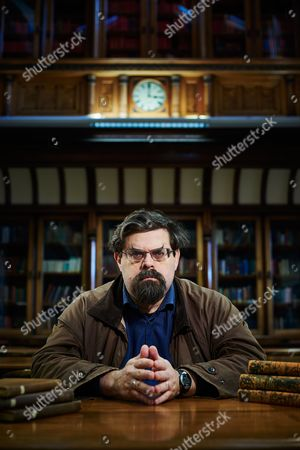 Stock Photo of Leeds United Kingdom - February 3: Portrait Of British Fantasy And Science Fiction Author Adrian Tchaikovsky Photographed At The Central Library In Leeds On February 3