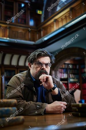 Stock Picture of Leeds United Kingdom - February 3: Portrait Of British Fantasy And Science Fiction Author Adrian Tchaikovsky Photographed At The Central Library In Leeds On February 3
