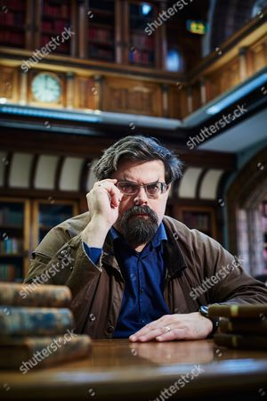 Stock Image of Leeds United Kingdom - February 3: Portrait Of British Fantasy And Science Fiction Author Adrian Tchaikovsky Photographed At The Central Library In Leeds On February 3