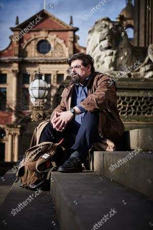 Stock Picture of Leeds United Kingdom - February 3: Portrait Of British Fantasy And Science Fiction Author Adrian Tchaikovsky Photographed At Leeds Town Hall On February 3