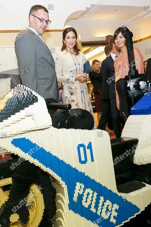 Her Royal Highness the Crown Princess Mary Elizabeth Donaldson (C) looks at a Police motorcycle made of LEGO bricks on display during a business seminar at Hotel Gajoen Tokyo