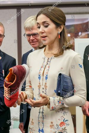 Her Royal Highness the Crown Princess Mary Elizabeth Donaldson looks at the Danish products on display during a business seminar at Hotel Gajoen Tokyo