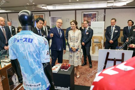 Her Royal Highness the Crown Princess Mary Elizabeth Donaldson (C) looks at the Danish products on display during a business seminar at Hotel Gajoen Tokyo