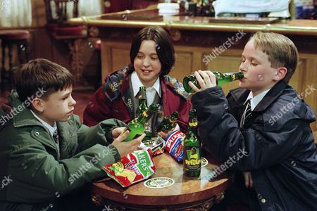 Stock Image of Ep 2181 Tuesday 25th March 1997 While Turner and Terry are away Donna offers Robert and Andy some Alco-pop in the Woolpack. Robert gets drunk but Donna ends up on the floor having spasms - With Andy Hopwood, as played by Kelvin Fletcher ; Robert Sugden, as played by Christopher Smith ; Donna Windsor, as played by Sophie Jeffrey.