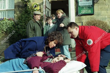 Ep 2181 Tuesday 25th March 1997 While Turner and Terry are away Donna offers Robert and Andy some Alco-pop in the Woolpack. Robert gets drunk but Donna ends up on the floor having spasms - With Andy Hopwood, as played by Kelvin Fletcher ; Donna Windsor, as played by Sophie Jeffrey ; Alan Turner, as played by Richard Thorp ; Vic Windsor, as played by Alun Lewis ; Viv Windsor, as played by Deena Payne.