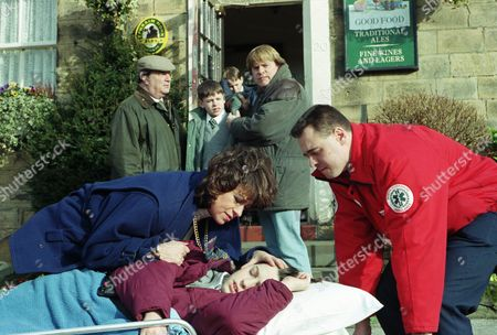 Stock Picture of Ep 2181 Tuesday 25th March 1997 While Turner and Terry are away Donna offers Robert and Andy some Alco-pop in the Woolpack. Robert gets drunk but Donna ends up on the floor having spasms - With Andy Hopwood, as played by Kelvin Fletcher ; Donna Windsor, as played by Sophie Jeffrey ; Alan Turner, as played by Richard Thorp ; Vic Windsor, as played by Alun Lewis ; Viv Windsor, as played by Deena Payne.